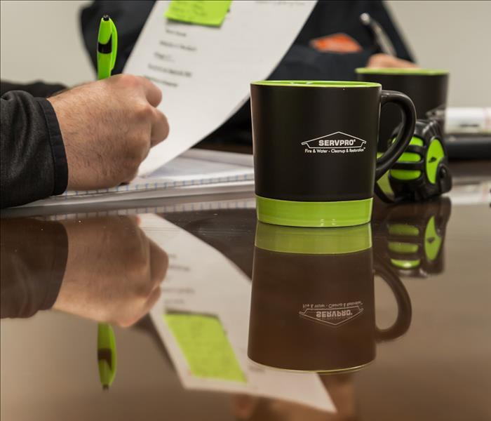 SERVPRO technicians around a table