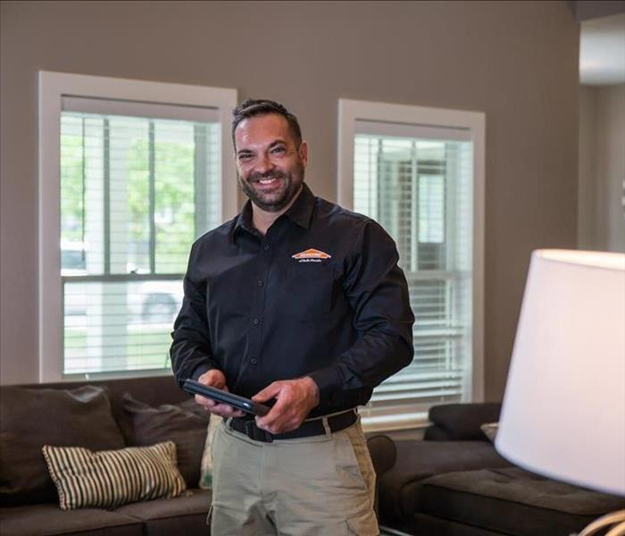SERVPRO technician in residential property